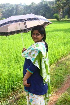 Free Indian Village Girl Holding Umbrella In Sunlight Stock Photo - 22569400