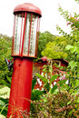 Free Antique Red Gas Pump Sitting Near A Shed Royalty Free Stock Image - 22573546