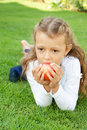 Free Girl Eating An Apple Royalty Free Stock Photo - 22575895