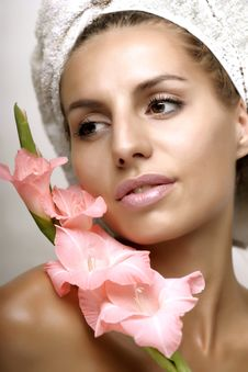 Young Woman With Flower And Towel Stock Photo