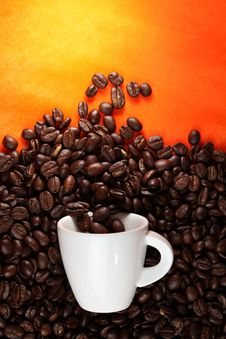 Free Coffee Cup With Beans On Orange Background Stock Photos - 22574703