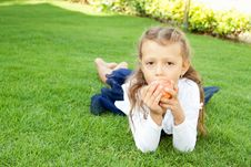 Free Girl Eating An Apple Royalty Free Stock Photos - 22575918