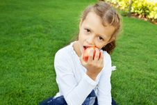Free Girl Eating An Apple Stock Image - 22575951
