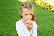 Free Girl Eating An Apple Royalty Free Stock Photo - 22575965