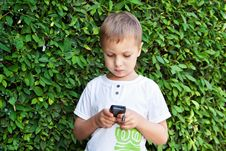 Free Cute Boy With Mobile Phone Stock Images - 22576004