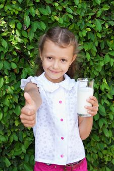 Girl Holding A Glass Of Milk Stock Photography