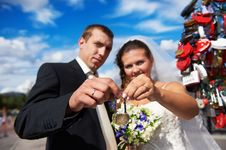 Happy Bride And Groom With Padlock Stock Photos