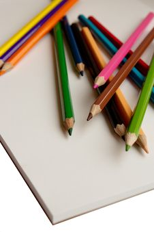Colored Pencils And Album Stock Photo