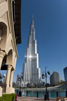 Burj Khalifa Against A More Traditional Building Royalty Free Stock Images