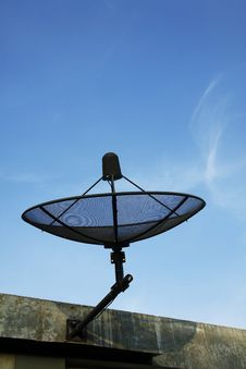 Satellite Dish In Blue Sky Stock Photo