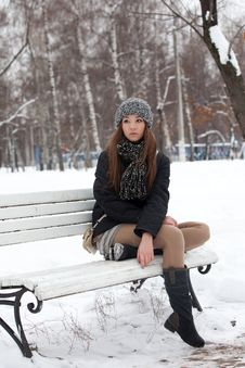 Free Girl On A Bench In The Winter Royalty Free Stock Image - 22599916