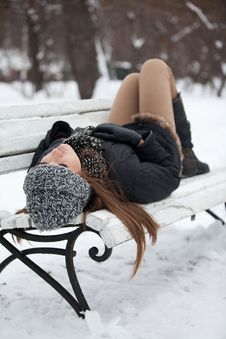 Girl On A Bench In The Winter Stock Photos