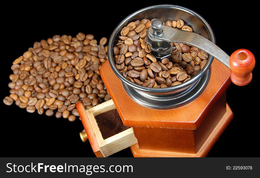 A coffee wooden  grinder black