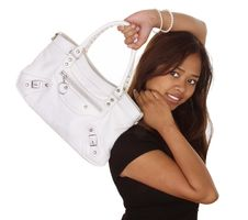 Free Woman Holding A Purse Royalty Free Stock Photography - 2260647