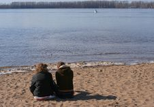 Two Girls Sitting On The Beach Stock Images