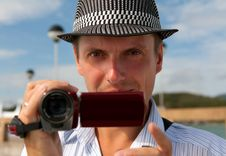Free Man In A Hat With A Camera Royalty Free Stock Photo - 22601395
