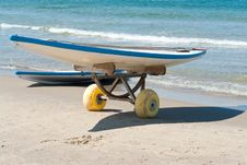 Free Surf Boards On A  Sandy Beach Stock Image - 22608351
