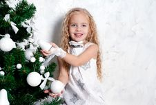 Free Little Girl And Christmas Tree Stock Images - 22610224