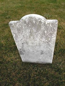 Free Old Unmarked Headstone On Grass Royalty Free Stock Image - 22617076
