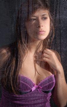 Free Woman Gazing Out Rainy Window Royalty Free Stock Photos - 22654408