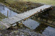 Free Simple Wooden Bridge Across Regulated Stream Stock Photo - 22665330