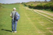 Free Senior Man Hiking Over Field In Summer Stock Photography - 22668122