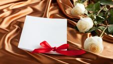 Card With White Roses On Golden Silk Background Royalty Free Stock Photography