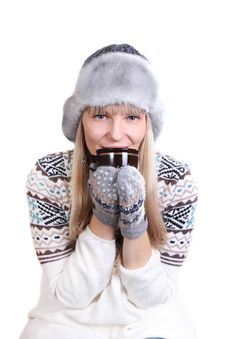 Beautifu Woman In Fur Hat With A Cup Stock Image