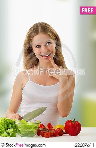 Free Happy Girl Preparing Vegetarian Food Stock Image - 22687611