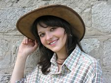 Young Cowgirl Near The Wall Stock Photo
