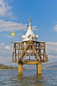 Part Of Thai Church Bell Tower Expose In The River Stock Image