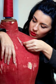 Free Seamstress Repairs Red Old Mannequin Stock Photos - 22697263