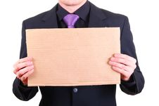 Businessman With Blank Cardboard Sign Stock Photography