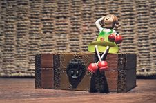 Free A Doll On A Wooden Box Royalty Free Stock Image - 22704406
