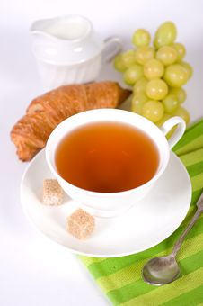 Free Delicious Breakfast. A Cup Of Tea, Croissant And G Stock Image - 22707121