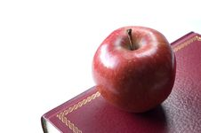 Free Red Apple For Teacher Resting On A Book Royalty Free Stock Images - 22708569