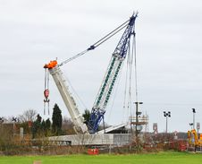 Free Heavy Duty Crane Erecting A Road Bridge Stock Photography - 22719702
