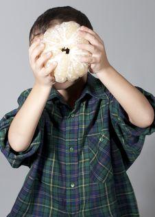 Free Little Boy Holding Pomelo Stock Photos - 22726803