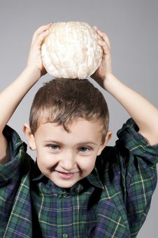 Free Little Boy Holding Pomelo Royalty Free Stock Photos - 22726858