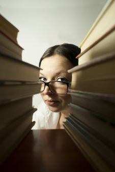 Free Girl Peeking From The Books Royalty Free Stock Image - 22736896