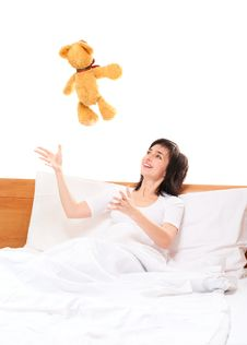 Free Woman In Bed Throwing Teddy Bear Royalty Free Stock Image - 22753746