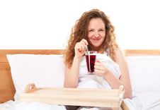Happy Redhead Woman In Bed Stock Image