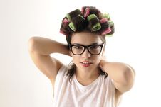 Free Girl Arranging Hair With Curlers Royalty Free Stock Images - 22760609