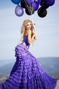 Free Beautiful Girl In The Purple Dress With Balloons Royalty Free Stock Images - 22776499