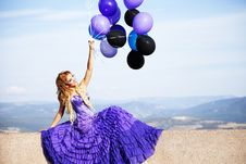 Free Beautiful Girl In The Purple Dress With Balloons Stock Image - 22776591