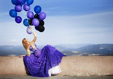 Free Beautiful Girl In The Purple Dress With Balloons Royalty Free Stock Photo - 22776665