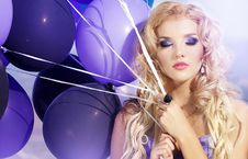 Free Beautiful Girl In The Purple Dress With Balloons Stock Photo - 22776690