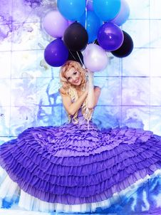 Free Beautiful Girl In The Purple Dress With Balloons Stock Photos - 22776923