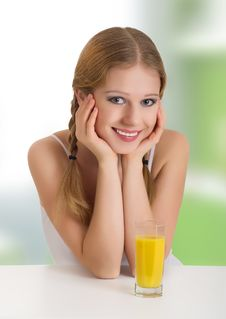 Free Beautiful Happy Cheerful Girl With Orange Juice Stock Photos - 22779423