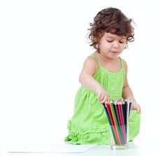 Little Girl Drawing With  Pencils Royalty Free Stock Images